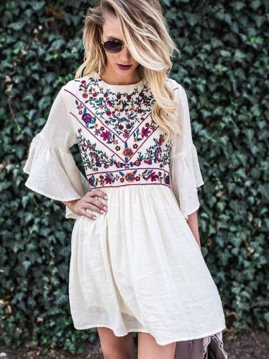 02-white-mini-dress-with-ruffled-sleeves-and-colorful-floral-embroidery-on-the-bodice
