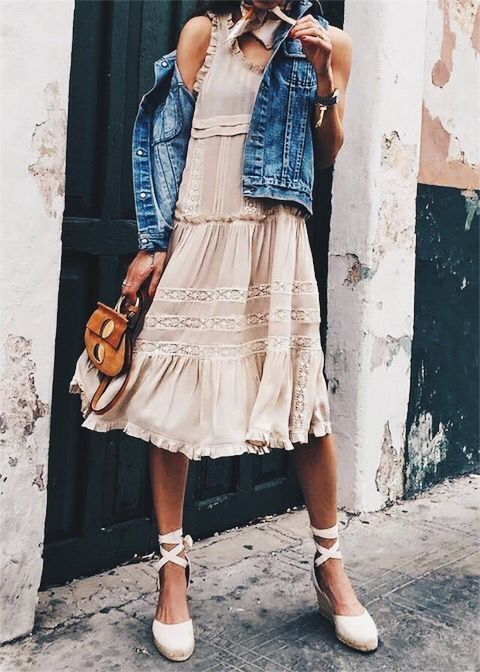 09-a-blush-knee-dress-with-ruffles-and-white-lace-detailing-with-a-denim-vest-and-lace-up-shoes