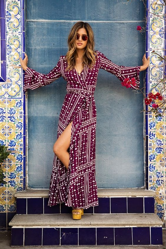 11-a-burgundy-and-white-printed-wrap-dress-with-long-bell-sleeves-a-V-neckline-and-a-front-slit