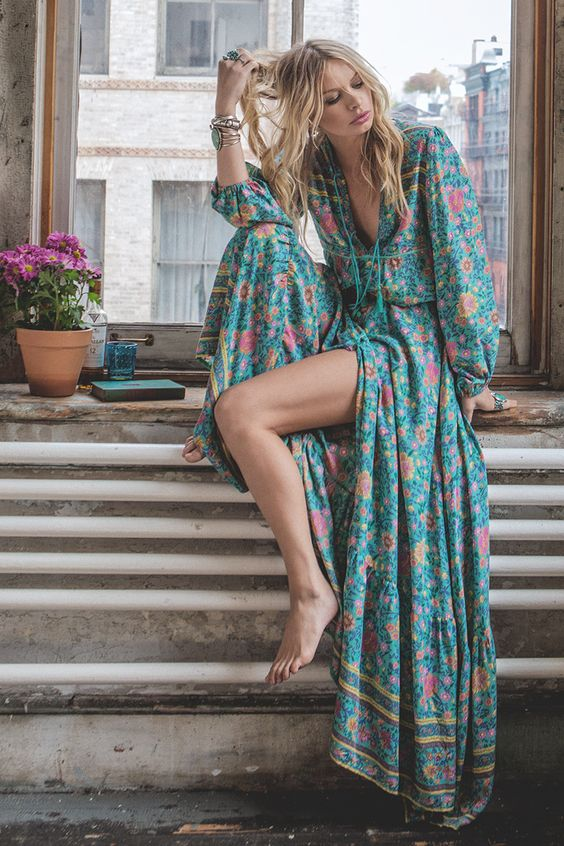 12-a-colorful-floral-print-maxi-dress-with-long-sleeves-a-deep-laced-up-V-cut-and-a-front-slit